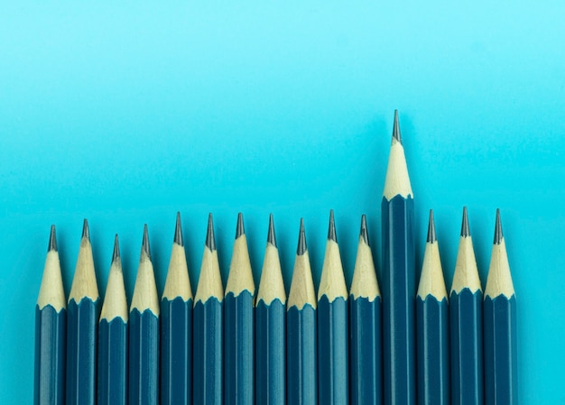 Pencil on blue background, concept as special and different concept