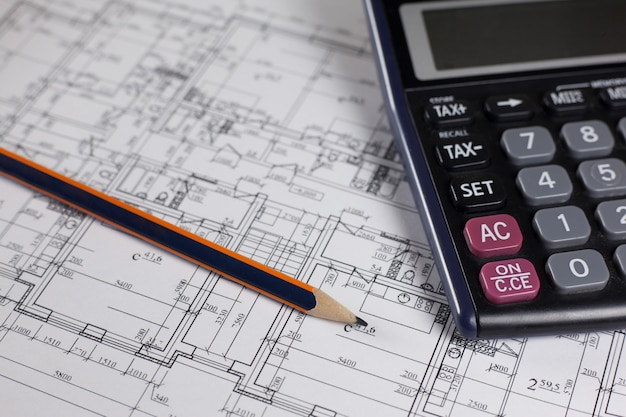 Pencil, calculator and plan of house