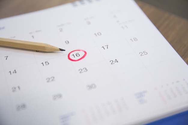 The pencil points to the number 16 in the calendar.