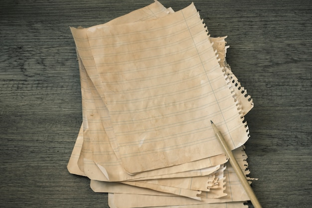 Pencil and stack of ruled paper
