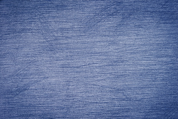 Pencil strokes on the paper, pencil drawing texture abstract background toned in trendy color 2020 year classic blue.