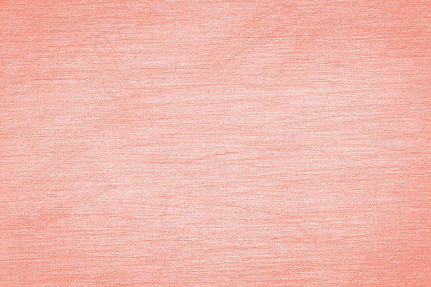 Pencil strokes on the paper, pencil drawing texture abstract background toned in trendy color 2020 year coral pink.