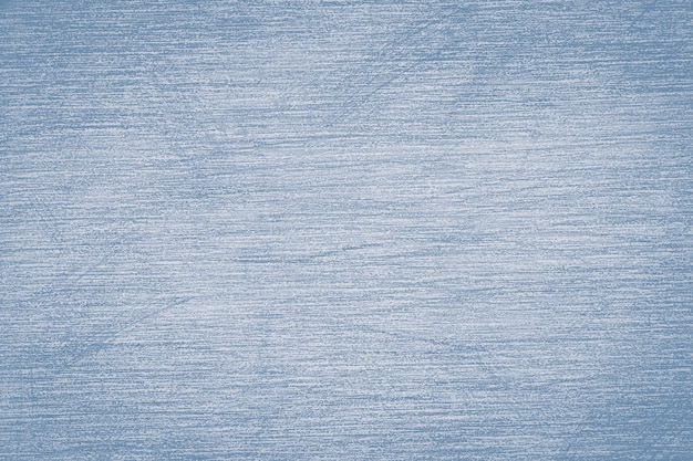 Pencil strokes on the paper, pencil drawing texture abstract background toned in trendy color 2020 year faded denim.