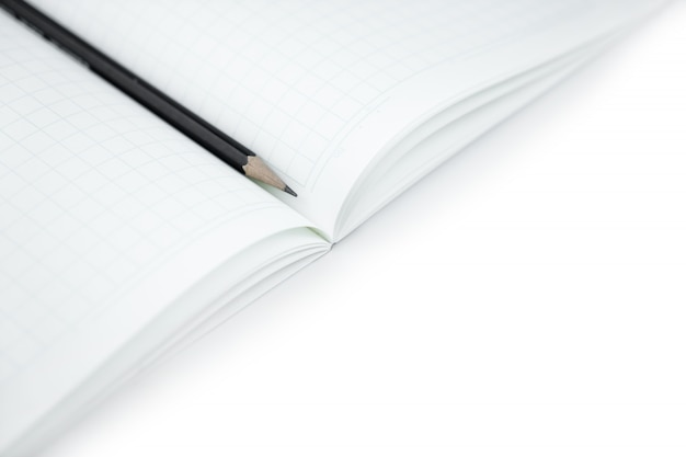 Pencil with blank notebook on isolated white for learning japanese language writing words.