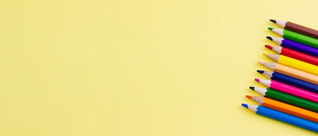 Pencils for drawing on a yellow background.