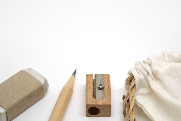 Pencils, erasers, pencil sharpeners and fabric bag