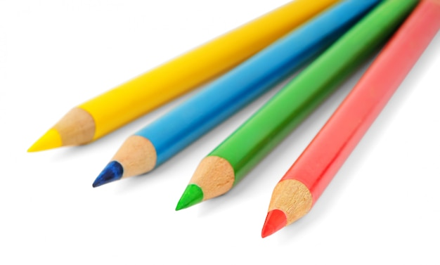 Pencils of four different colors isolated on white wall (selective focus)