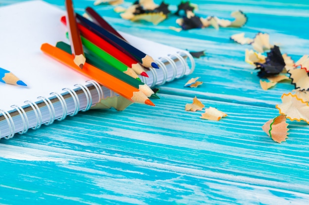Pencils, pencil cuts and blank paper on a desk table