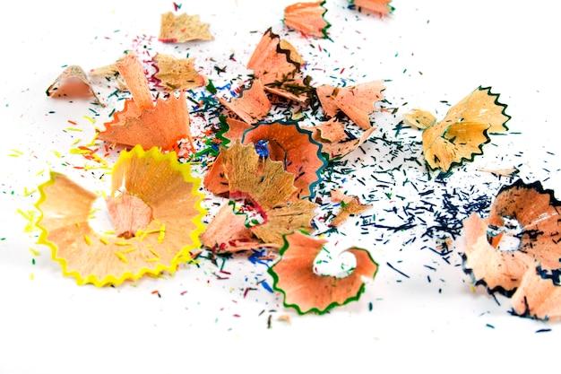 Pencils sawdust background
