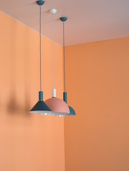 Pendant lights in orange interior.