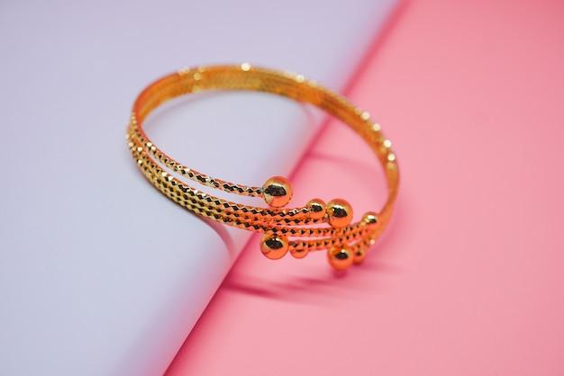Pendulum gold bracelet