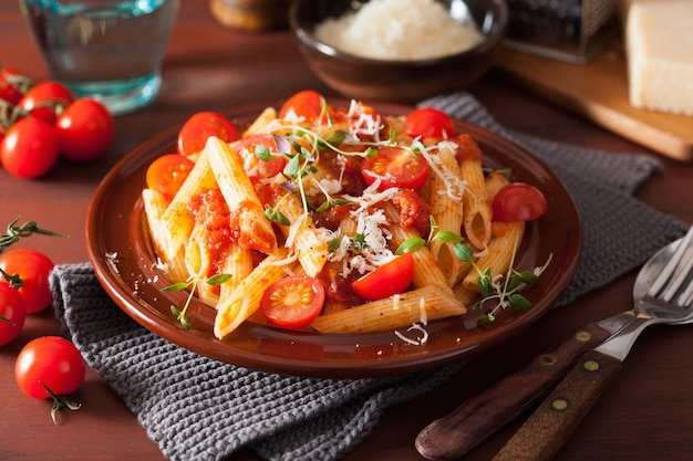 Penne pasta with tomatoes and parmesan