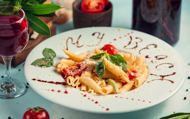 Penne pasta with tomatos, parmesan chees on top