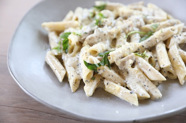 Penne pasta with white sauce and truffle , italian food