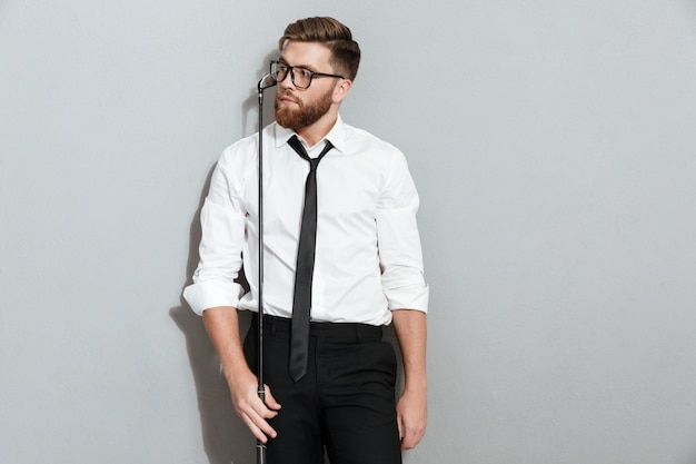 Pensive bearded man in eyeglasses and business clothes