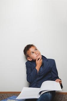 Pensive boy in jacket
