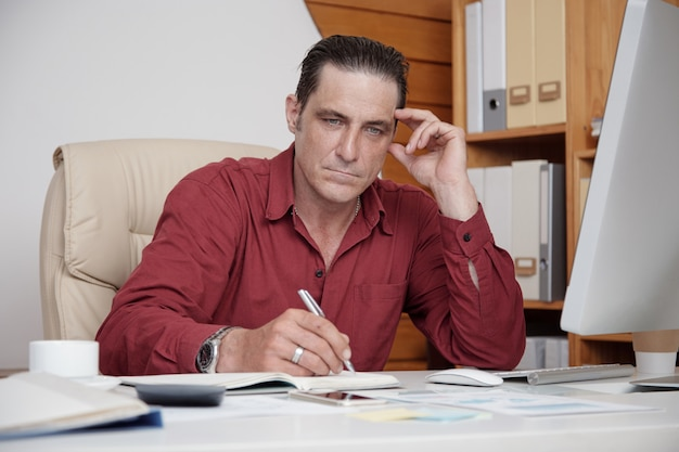 Pensive businessman planning his work