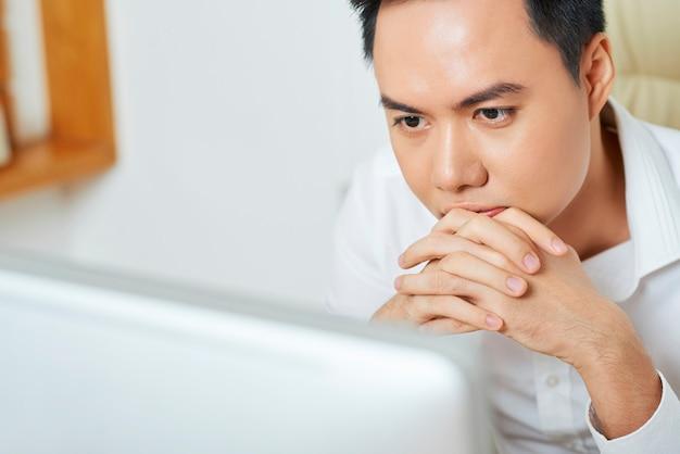 Pensive businessman reading e-mail