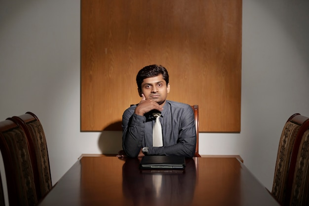 Pensive entrepreneur in an office