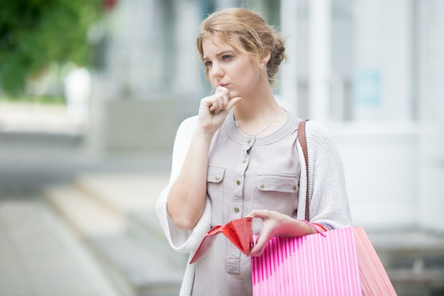 Pensive girl holding her purse