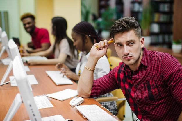 Pensive man at desktop