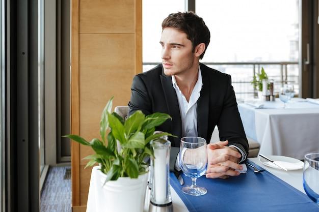 Pensive man in restaurant