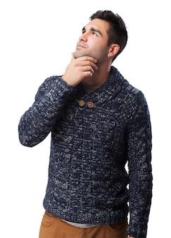 Pensive man touching his chin