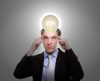 Pensive man with a light bulb on his head