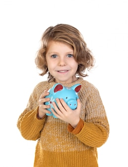 Pensive smiling child holding a moneybox