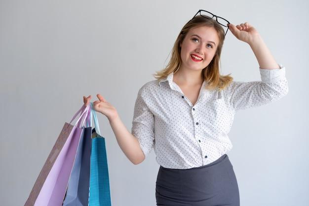Pensive smiling consumer enjoying shopping