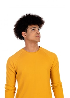 Pensive teenager boy wiht yellow t-shirt