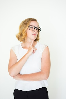 Pensive woman in glasses against white background