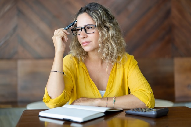Pensive woman trying to remember important thing