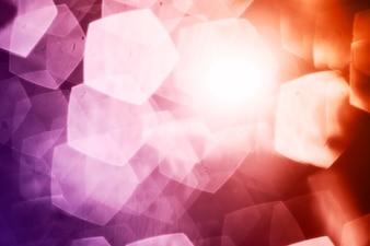 Pentagon specks on warm background