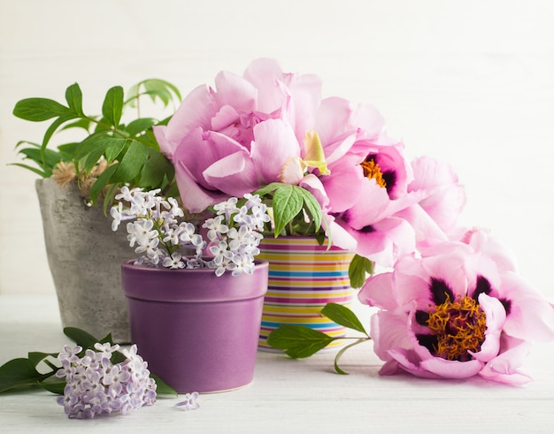 Peonies and lilac flowers