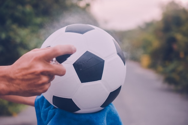 People alcohol spray cleaning soccer football