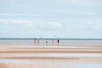 People along shoreline at Manda Bay Resort