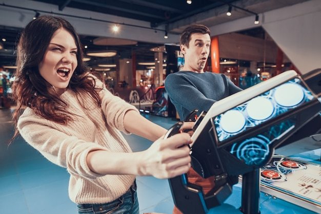 People are piloting aircrafts playing in arcade