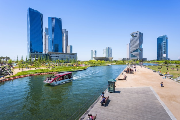 People are riding a tourist boat in summer of korea at central park in songdo district, incheon south korea.