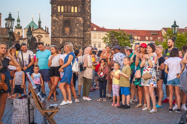 People are walking over the famous charles bridge in prague.