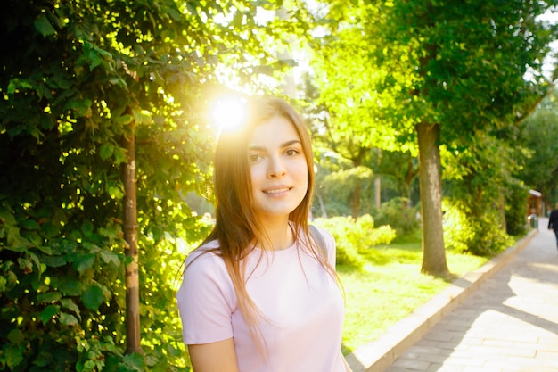 People, beauty, fashion, lifestyle and color concept - outdoor full body portrait of young beautiful happy smiling girl posing on street. model looking at camera. lady wearing stylish clothes