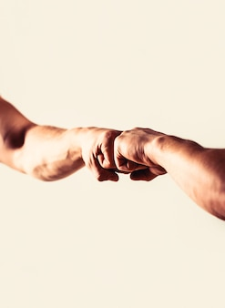 People bumping their fists together arms friendly handshake friends greeting hands of man people