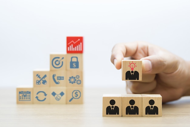 People and business symbols with wooden block.