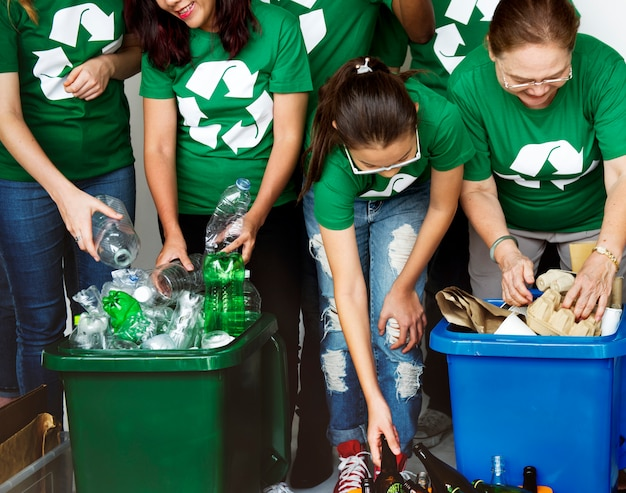 People caring for the environment by recycling
