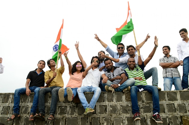 People celebrating independence day by dancing and waving indian flag or tricolour