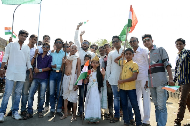 People celebrating republic day by dancing and waving indian flag