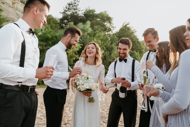 People celebrating a wedding on the beach