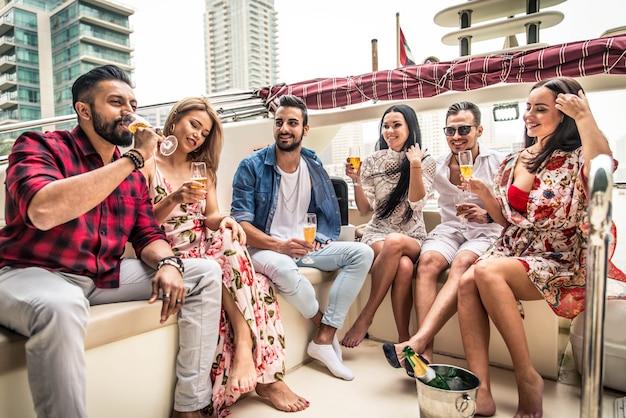 People celebrating on a yacht