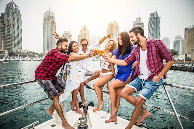 People celebrating on a yacht