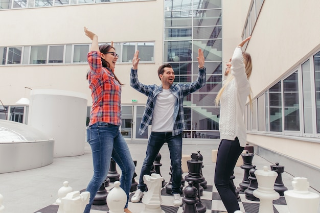 People chilling out on chess board